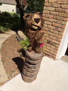 Chainsaw Carving - Bear on the Rocks - by Bob Ward, Amana, Iowa