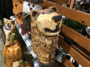 Funny bear sitting on a shelf - Chainsaw Carving by Bob Ward