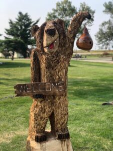 Onsite Welcome Bear Chainsaw Carving by Bob Ward, Iowa