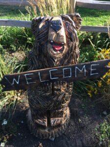 Whimsical Welcome Bear - Chainsaw Carving by Bob Ward - Colony Carvers - Amana, Iowa